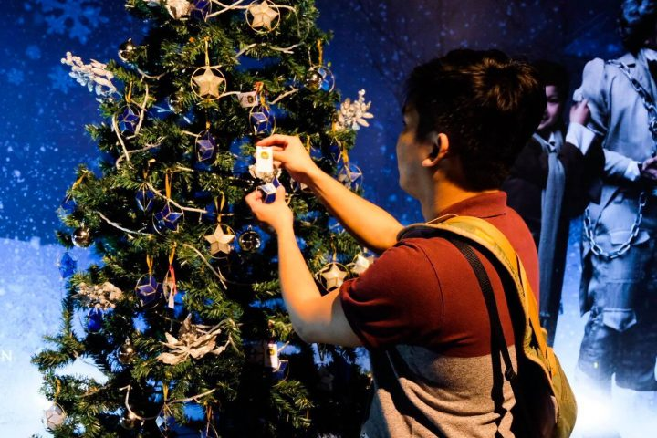 "Buy a Christmas star for just Php 200 and hang them on the Christmas trees at the ""Wall of Miracles"""